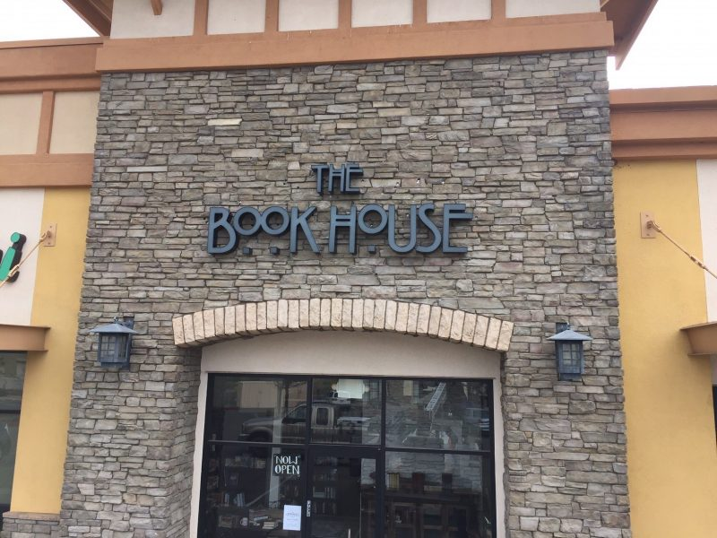 Custom storefront signs for The Book House Install