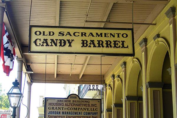 Old Sacramento Candy Barrel Hanging Signs in Sacramento, CA